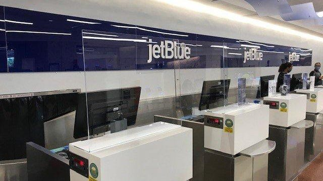"""During the 2020 coronavirus pandemic, Palm Beach International Airport installed acrylic """"transmission barriers"""" at ticket counters and gate podiums."""