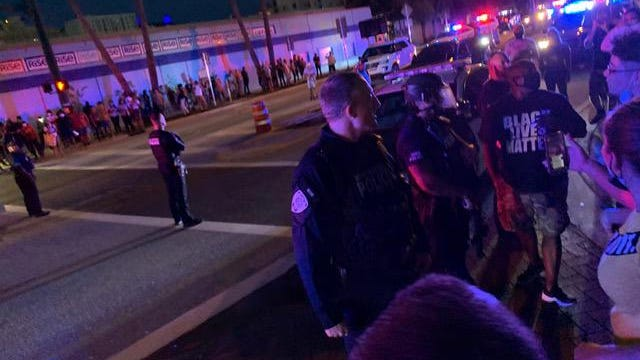Demontrators and West Palm Beach Police in riot gear appear on Clematis Street as things get tense Sunday night, May 31, 2020.