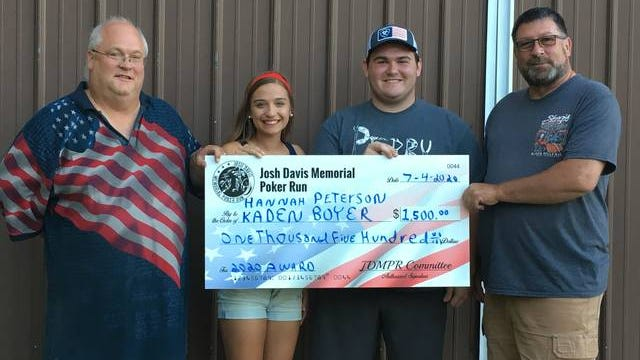 Dave Davis, left, and Jerry Anderson present memorial awards to Perry High School seniors Hannah Peterson and Kaden Boyer. CONTRIBUTED PHOTO