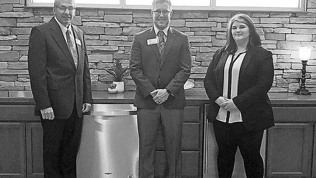 Pictured from left are Carter Davis, owner and Funeral Director in Charge, Jon Carter and Randi Trease, Funeral Director. Courtesy
