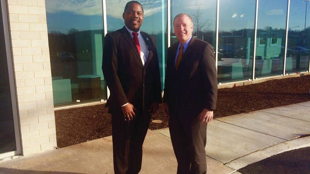 The sun shines off the glass exterior of Pinewood Springs behavioral hospital in Columbia. CEO Troy Chisolm, left, and Maury Regional CEO Alan Watson anticipate the Jan. 27 opening for patients.