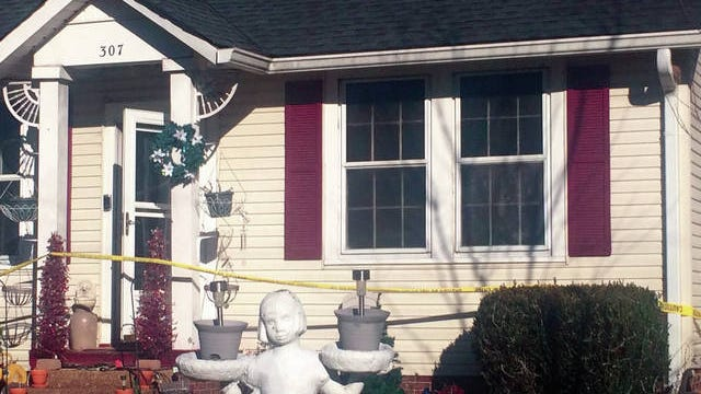 Yellow tape surrounds the home at 307 2nd Ave. this morning after a fire Tuesday night.