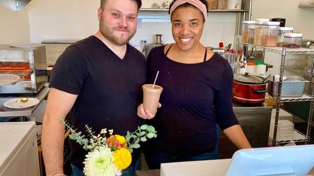 T.J. and Rachelle Hutt round out their first official day of business at the Little Juice Co., which opened Wednesday at the Columbia Arts Building.
