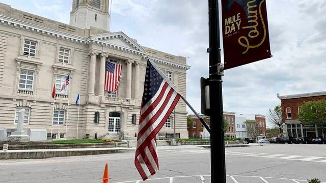 One of several U.S. flags hangs at the Maury County Courthouse square in downtown Columbia. The Columbia Lions Club hung more than 200 flags this week around the city. The flags were originally intended for Mule Day, and now hang as a symbol of unity as the city grips with the COVID-19 outbreak.