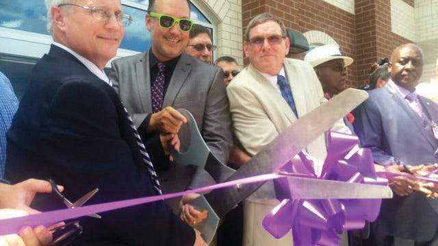 Principal Roger White, left, Maury County Director of Schools Dr. Chris Marczak, center, and former Director of Schools Eddie Hickman cut the ribbon, officially opening Central High School in July 2016.