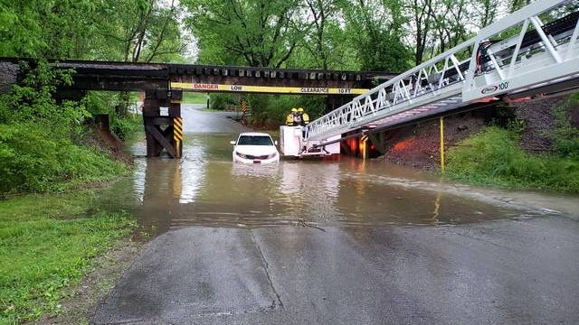 Columbia Fire & Rescue crews extract two passengers of a 2015 Kia Optima, which had become stuck in high flood waters just off Lion Parkway on Sunday. No injuries were reported.