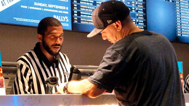 In this Sept. 5, 2019 file photo, a gambler making a sports bet at Bally's casino in Atlantic City, N.J. The NFL draft starting on Thursday is expected to be the most heavily wagered-on draft ever, mainly because virtually all major sporting events have been postponed due to the coronavirus outbreak.
