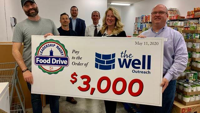 From left, The Well Director of Operations Joseph Knapp, Leadership Maury 2020 reps Todd Essig, Clint McCain and Kenny Boyd, The Well Executive Director Shelly Sassen and Leadership Maury member Marty Smith present the Spring Hill food pantry with a $3,000 check raised by community donations.