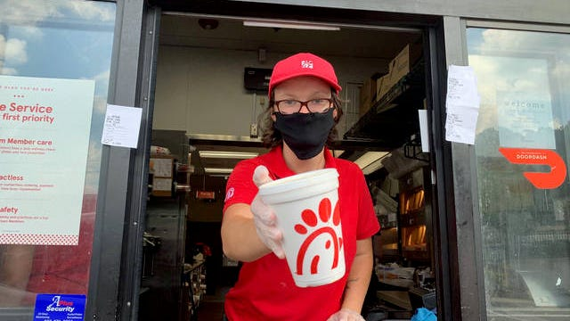 Chick-fil-A's Haley Tilley, a Columbia State Community College student, hands my peach shake out of the drive-thru window Thursday.