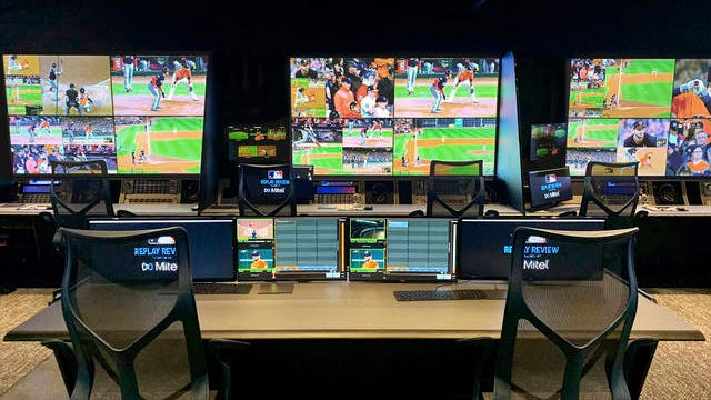 In this photo provided by MLB, Major League Baseball's new replay operations center and ballpark video rooms are viewed in New York in January. Major League Baseball has doubled the isolated camera angles available for video review from 12 to 24 and arranged for high-frame rate cameras to stream directly to the new replay operations center and ballpark video rooms. The shift to a new replay operations center twice the size of the old one is part of the move of Major League Baseball and MLB Advanced Media to a combined office space in Manhattan, across the street from Radio City Music Hall.