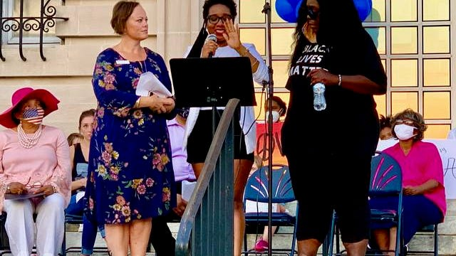 Jai Lipscomb of All Hands on Deck, center, speaks Sunday about the late Annie Hardison, whose work as a mentor and leader in the community was shared over the weekend in her memory. Hardison passed away Friday, July 24, 2020 at age 81.
