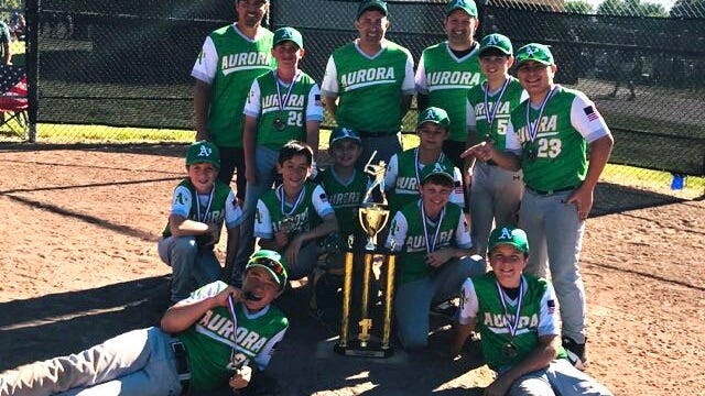 The age 12-and-younger Aurora Athletics baseball team won the Summer Series Bring the Heat tournament recently in Macedonia. The team finished 4-0. Pictured are, from left, front row: Cooper Driscoll and Curt Courtad; middle row: Benji Strosaker, Johnny Trivisonno, Jordan West, Zach Pannetti and Max Anzells; and back row: coach Mike Jones, Brock Habbyshaw, coaches Mike Trivisonno and Matt Anzells, Brayden Jones and Vinnie Courtad.