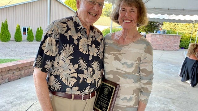 Dick Campell, with his wife, Cindy, received an honorary membership in Rotary Club of Alliance during a recent meeting, in honor of his community service efforts.