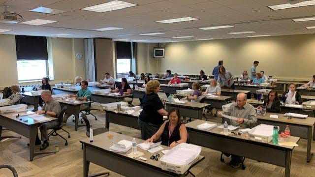 More than two dozen York County election workers count mail-in ballots on primary election Tuesday while social distancing.