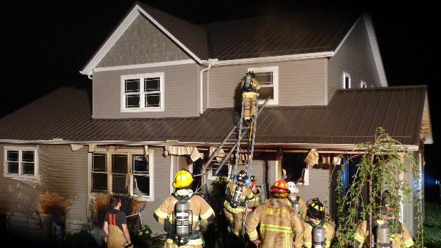 Firefighters battled a three-alarm fire at the Duane and Becky Miller family residence at 8960 Steinebrey Ridge Road NW, Sugarcreek, Friday night.