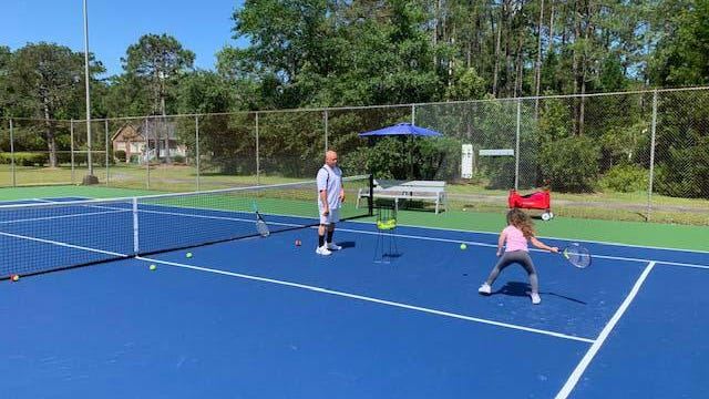 Paul Stokes and his five-year-old daughter Margot, future USTA Junior Champion, enjoy the new Red Sail Tennis Courts together.