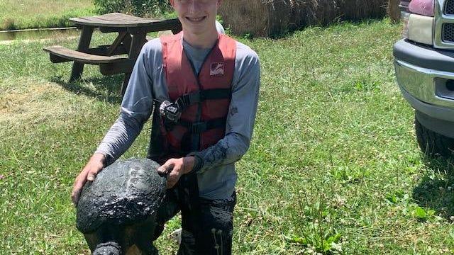 Reese Coulson, 16, of Port Washigton caught this huge snapper with his hands out of his aunt's pond. He is a student at Indian Valley High School. Submitted photo