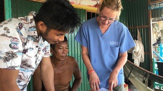 In Cambodia, Dr. Ann Messer of One Good Turn went into village health centers to train doctors and nurses who didn't have a lot of medical knowledge. Her trips abroad have been cut off by the pandemic, but she is still educating communities through resources such as the 'Corona Care Handbook.'