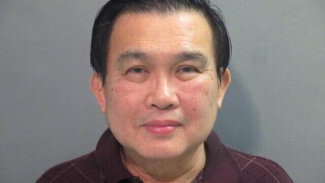 FILE - In this undated file photo provided by the Washington County (Ark.) Detention Center shows Simon S. Ang. Ang, a suspended University of Arkansas professor was indicted in Fayetteville, Arkansas, Tuesday, July 28, 2020, on multiple wire and passport fraud counts. The 44-count indictment accuses Ang, of failing to disclose close ties to the Chinese government and Chinese companies when he obtained federal grants.