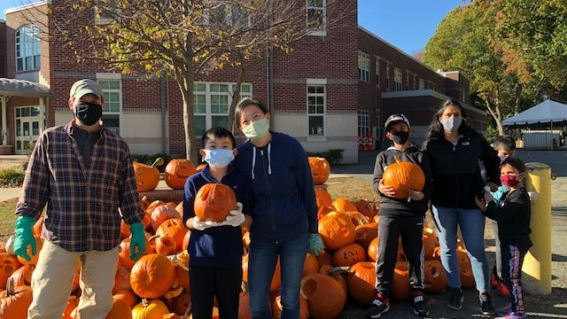 Parents and students with some of the pumpkins collected.
