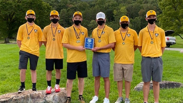 The Keyser Golden Tornado golf squad poses with their PVC championship hardwawre. Tribune photo by Chapin Jewell