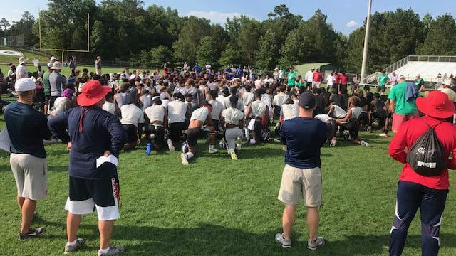 Greater Augusta FCA hosts a High School Football 7 on 7 Passing League Camp in June of each year. Here, Westminster's head football coach Andrew Bryan shares a devotional word with camp attendees in 2019.