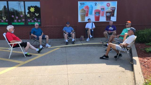 These seven gentleman were enjoying the beautiful weather and fellowship Wednesday morning.