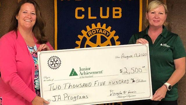 Rotary President Chanda Dowell presents a $2,500 to Junior Achievement Representative Jennifer Von Kaenel, Development Director during the weekly Rotary meeting Aug. 18 at First United Methodist Church. Rotary has over $50,000 earmarked for local not-for-profit organizations this year.