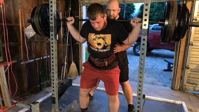 Eli Dertz gets some work in on his squat technique with his father and trainer/coach Chris Dertz at their home in Lanark.