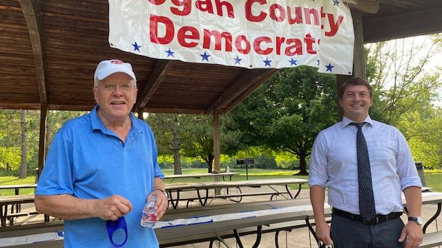 Logan County Democrat chairman Gary Davis, left, stands next to George Petrillii, right, who is running for the 18th Congressional District of Illinois in November.