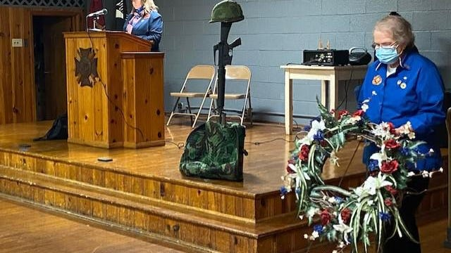 VFW Commander Michelle Ramlow introduces Past President of VFW Auxiliary Janet Long who performed the ceremonial laying of the wreath during Wednesday's Veterans Day ceremony at the VFW.