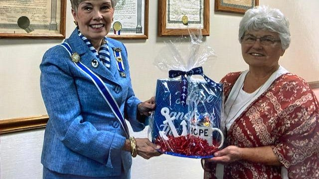 """The Abraham Lincoln Chapter of the National Society of Daughters of the American Revolution recently hosted the Illinois State Regent, Sharla Luken. Her goal for the state is strength through service and an anchor representing the state symbol. Linda Churchill, of Lincoln, presented Luken with an anchor themed gift to show the chapters appreciation for her service. The DAR State Regent program was based on """"Serving others who have served us."""""""