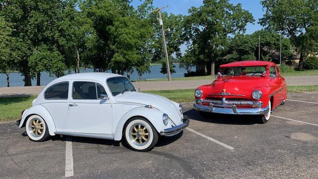 This photo submitted by Ed White shows a white 1969 VW Beatle and a red 1950 Mercury.