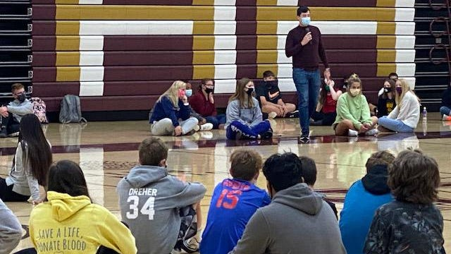 Derek Ingalls, education and prevention specialist at Jana's Campaign, facilitates the conversation among Hays High freshman students.