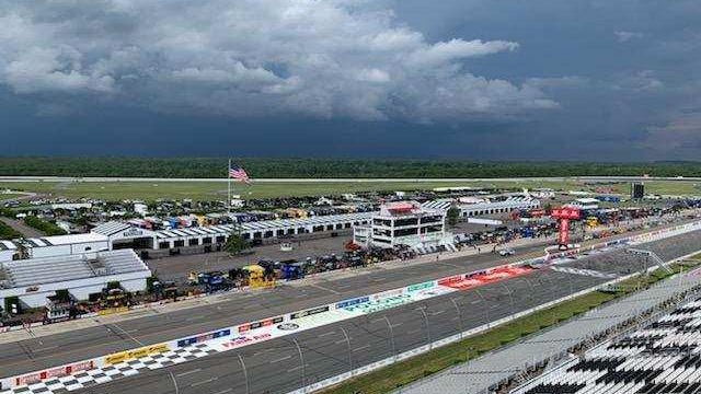 In this photo taken by Steve Barkdoll from the roof at the track, storm clouds roll in at Pocono Raceway on Sunday just prior to the NASCAR Series Cup race.