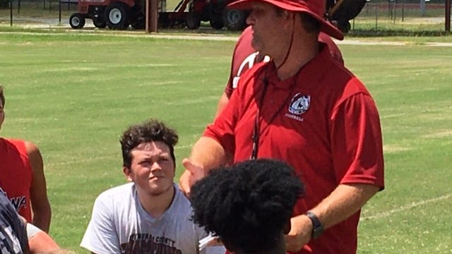 South Effingham football coach Nathan Clark talks to the team after practice. Clark and the Mustangs prepare for rival Effingham County on Friday.