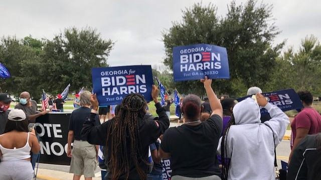 Biden/Harris supporters and Trump/Pence supporters were seen at Savannah State University's campus ahead of Jill Biden's rally Monday.
