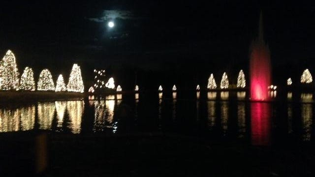 A full moon hangs over the lake in McAdenville during the Christmas season.