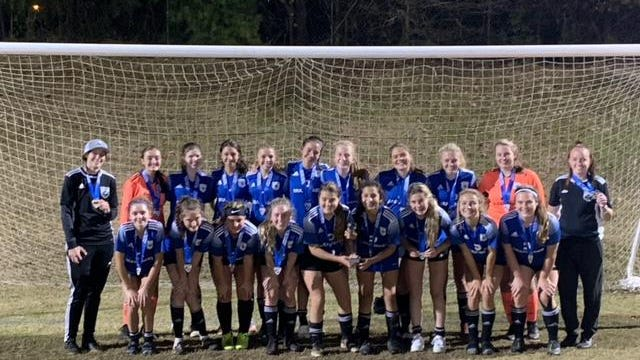 The Carolina Football Club 2004 Girls Elite team poses after winning the President's Medal League State Cup on Nov. 15 in Greer, SC. Pictured from left to right are, back row: Coach Ashely Crompton, Laura Shelton, Cheyenne Sherman, Alexa Sierra, Addison Adams, Kai Clark, Melodi Van't Hoff, Lillian Flores, Emma Jones, Molly Moore; front row: Lilly Rogers, Tru Segal, Tori Knight, Alayna Denny, Hunter Hill, Emma Chavez, Julia Ledbetter, Olivia Payne, Lucy Denny and Coach Camryn Coggins.
