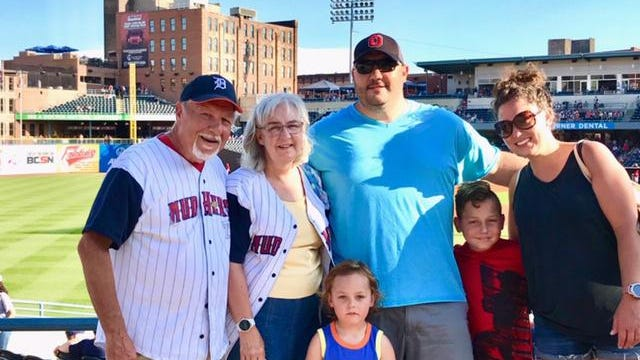 Mike and Jonalea Thomas of Lambertville attend a 2018 Toledo Mud Hens game with their son Justin, daughter-in-law Kristin, and grandchildren Barrett (center) and Hudson (second from right).