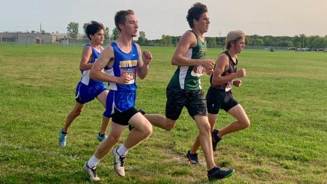 Will Robinson of Jefferson (left front) competes against St. Mary Catholic Central's Andrew Wickenheiser, Milan's Brayden Humes (right) and teammate Carter Mccalister in the Puddle Jumpers Invitational Tuesday. Robinson won the race to lead the Bears to the title.