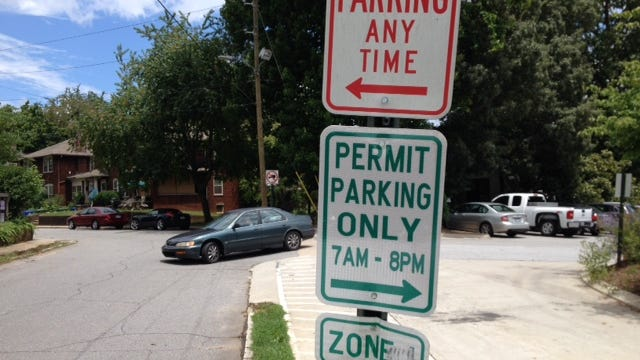 Parking is allowed by permit only on Maxwell Street behind GreenLife.