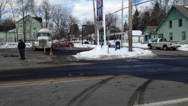 East Emmett Street is soaked with gasoline after a 2,000-gallon spill Monday afternoon at North McKinley Avenue.