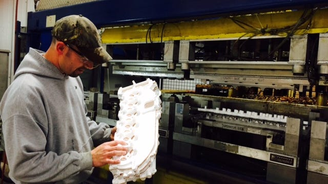 Jim Rosenthal, a machine operator at ACH Foam Technologies in Fond du Lac, inspects an expanded polystyrene mold that will be used to create engine power train components.