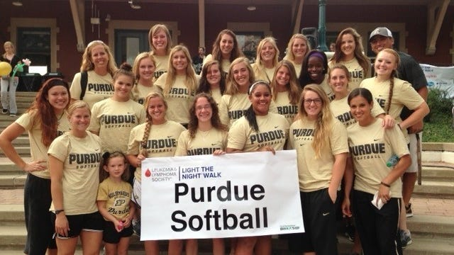 Members of the Purdue softball team pose before the 2013 Light The Night Walk at Riehle Plaza.