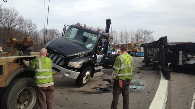 Crews worked to remove an overturned semi truck from the ramp from eastbound I-96 to northbound U.S. 127 on Tuesday afternoon.