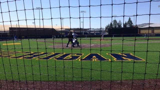 A Salem batter gets ready for the next pitch from Plymouth's Cameron Stella during the first game of Saturday's baseball twinbill at the University of Michigan's Ray Fisher Stadium. The Rocks and Wildcats split the doubleheader.