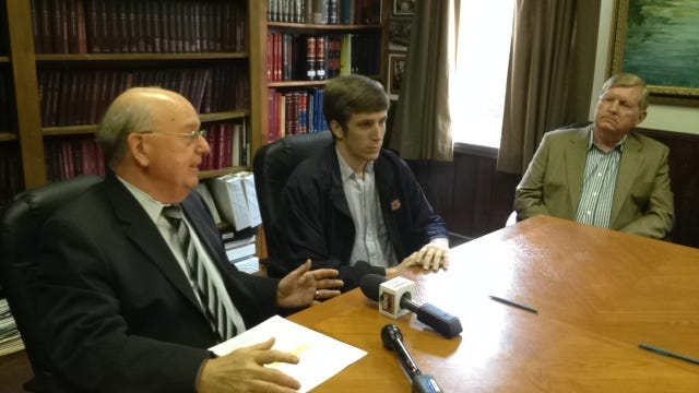 Montgomery attorney Julian McPhillips, left, announces a claim against the Lee and Tallapoosa county sheriff's departments Monday along with Britt Thomas and his grandfather, Ray Thomas, in McPhillips' office.
