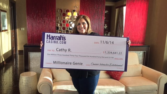 Morris County resident Cathy Ruela holds a ceremonial check at Harrah's Casino in Atlantic City after winning more than $1.3 million playing a Harrah's online slot game at her home on Nov. 6.