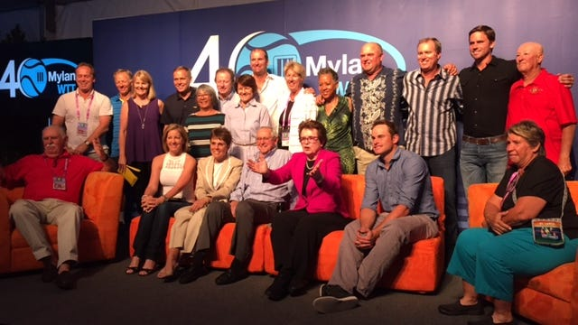 The group poses for a photo during the Mylan World TeamTennis 40th anniversary celebration.